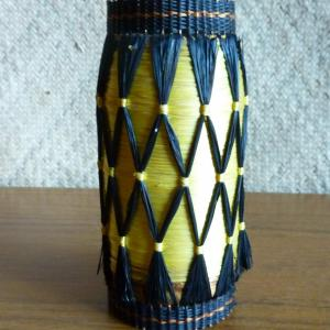 vintage_foreign_yellow_and_black_covered_small_bottle